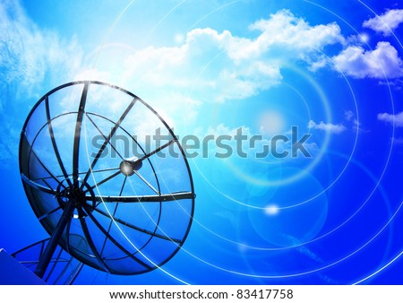 Satellite dish on blue sky day - stock photo