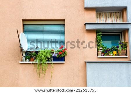 satellite dish on house facade - stock photo