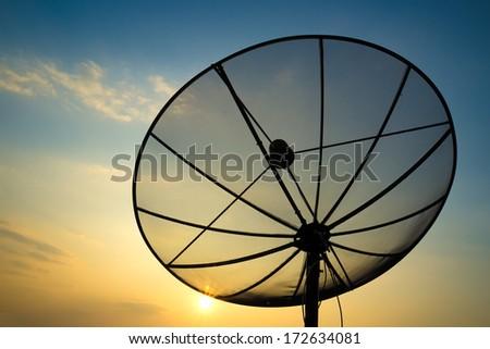 satellite dish on sunset blue sky, skies - stock photo