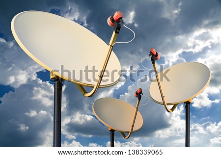 Satellite dish on the blue sky with cloud. - stock photo