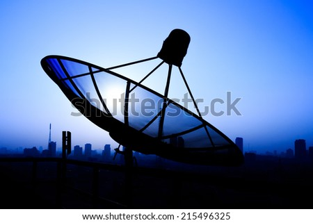 Satellite Dish on the Roof at Sunrise. - stock photo