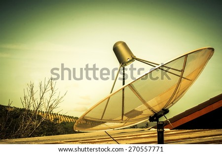 satellite dish on the roof, In rural have satellite dish for entertainment and news - stock photo