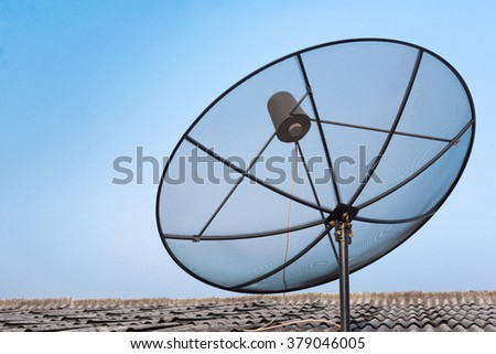 Satellite dish on the roof with blue sky  - stock photo