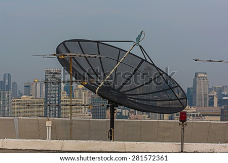 satellite dish on top high tower. - stock photo