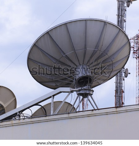 Satellite dish space technology receiver - stock photo