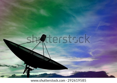 Satellite dish transmission data on colorful cloudy - stock photo