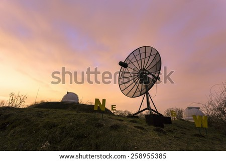 Satellite dish used in an astronomical observatory. - stock photo