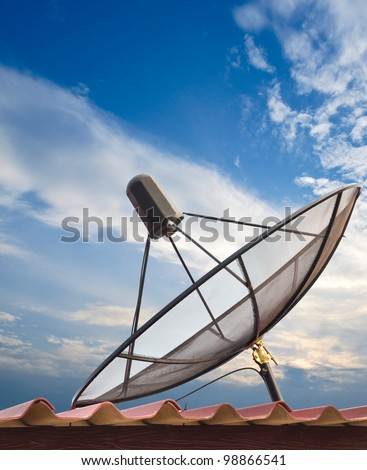 Satellite dish with blue sky - stock photo
