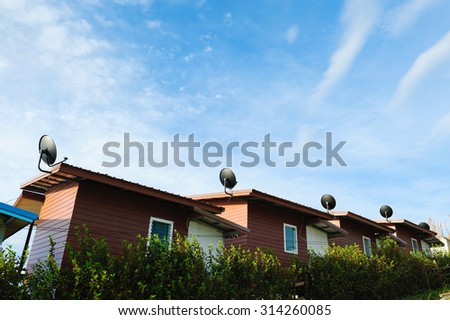 Satellite dish with cloud sky on roof - stock photo