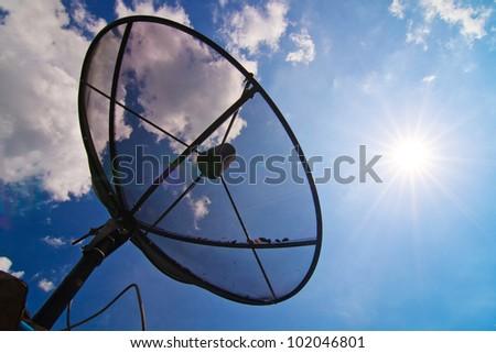 satellite dish with sunshine blue sky - stock photo