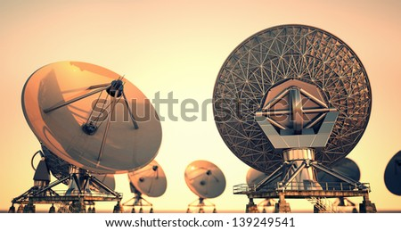 Satellite dishes at twillight.