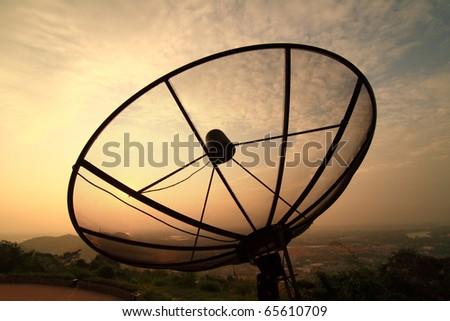 Satellite dishes atop a mountain - stock photo