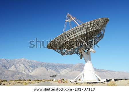Satellite dishes in desert / clear blue sky - stock photo