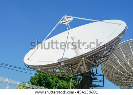 Satellite dishes line in bangkok with blue sky  - stock photo
