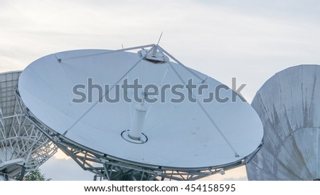 Satellite dishes line in bangkok with clouds in rainny day. - stock photo