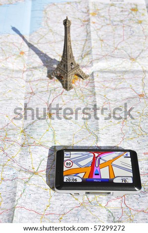 Satellite navigation system and Eiffel tower on a map - stock photo