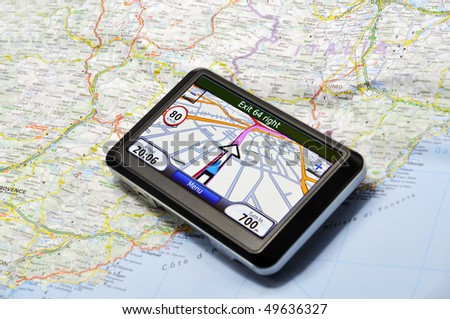 Satellite navigation system on the map - stock photo