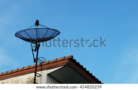 satellite on the roof with blue sky