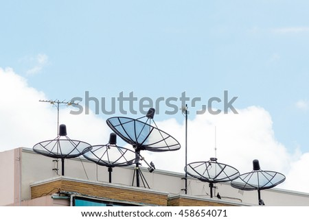 satellite on top in blue sky cloudy background