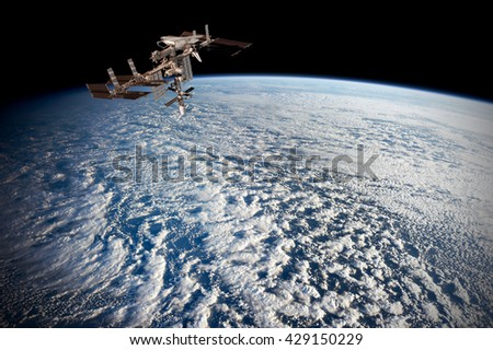 Satellite planet Earth ocean international meteorology telecommunication outer space station iss. Elements of this image furnished by NASA. - stock photo