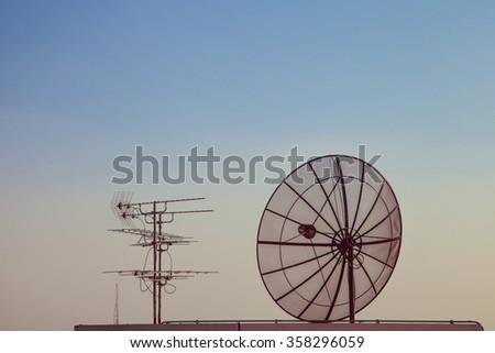 Satellite TV antenna - stock photo