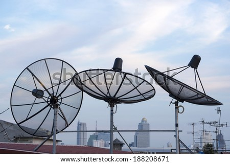 satellites dishes antenna on roof top among the city