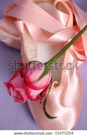 Satin Ballet shoe with a pink rose