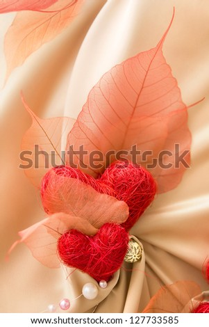 Satin decoration with transparent leaves and red Valentine hearts - stock photo