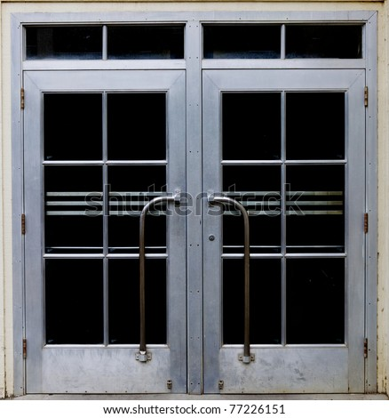 Satin finish 1930's style glass and steel doors - stock photo