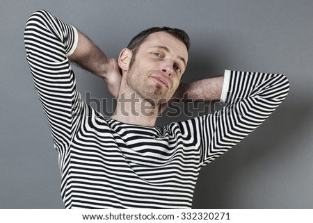 satisfaction and smile concept - satisfied middle age man with both hands on neck expressing happiness and wellbeing