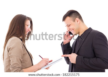satisfied and happy businessman on the phone and his secretary writing down notes