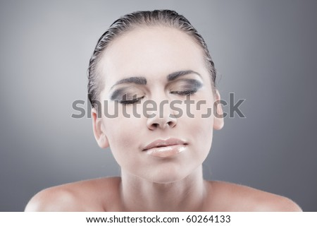 Satisfied dreaming brunette woman with closed eyes smiling
