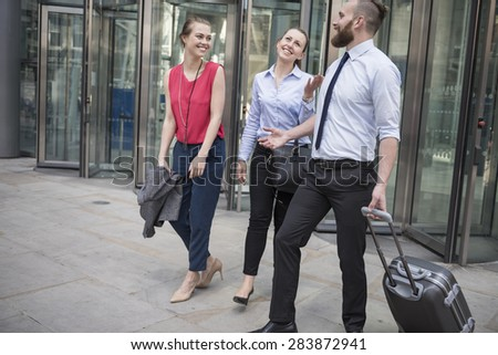 Satisfied group of business people after the meeting  - stock photo