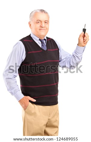 Satisfied mature man holding a car key isolated on white background - stock photo
