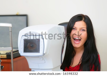 satisfied patient after the sight testing - stock photo