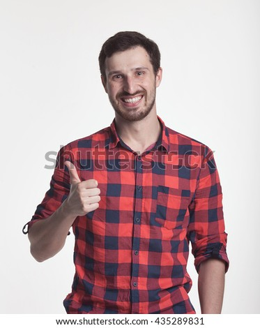 Satisfied Positive Man Gesturing Ok Sign Isolated On Grey Background.man holding his thumb up - stock photo