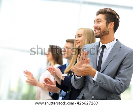 Satisfied proud business team clapping hands