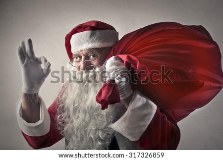 Satisfied Santa Claus - stock photo