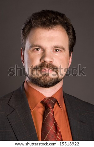 Satisfied smiling businessman