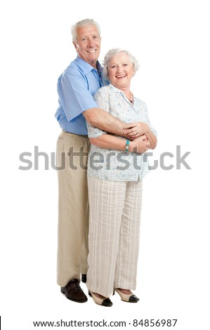 Satisfied smiling senior couple standing full length together isolated on white background - stock photo