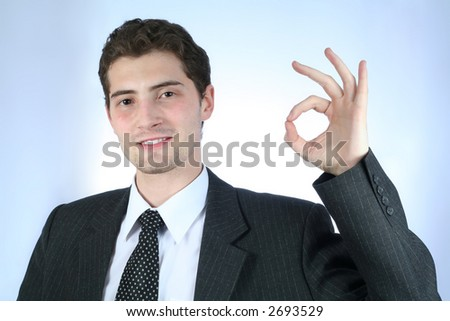 "Satisfied white-collar worker with ""All right"" sign over sky-blue background"
