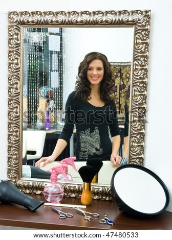 satisfied woman in hair salon - stock photo