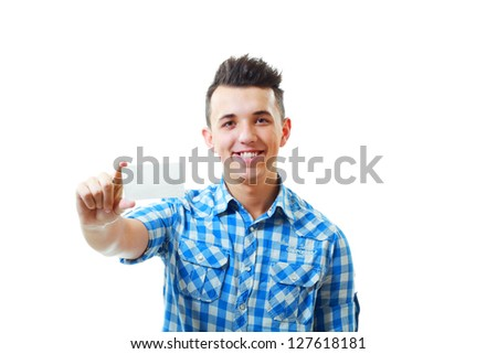 Satisfied young handsome man holding and showing blank card ready for your text - stock photo