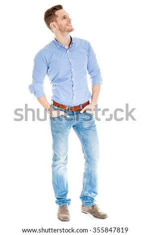 Satisfied young man looking at empty space - full length shot isolated on white background