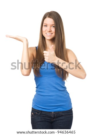Satisfied young woman showing open empty palm with place for product