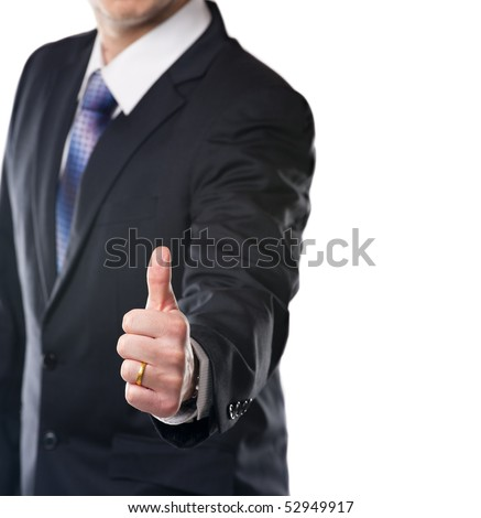 Satisfy businessman showing thumb up. Studio shot with copy space.