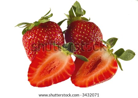Satrawberries isolated on white background with one cutted in two parts - stock photo