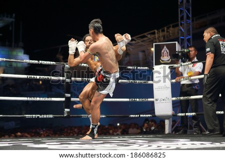 SATTAHIP-APRIL 6 : Action of Muay Thai fight between Leo Pinto. (France) and Cody Moberly (Canada) during Jakree Thai Fight 2014 on April 6, 2014 in Sattahip, Chonburi, Thailand