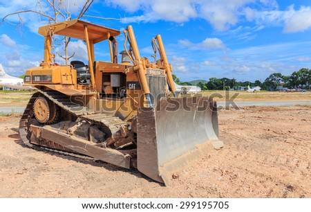 SATTAHIP CHONBURI - JULY,23 : CAT bulldozer sits at rest on a construction site in blue sky day. THAILAND JULY,23 2015 - stock photo