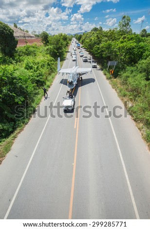 SATTAHIP CHONBURI - JULY 23,2015 :The Royal Thai Navy are working on highway That transportation the old useless A-7 fighter airplane to set in new museum.THAILAND JULY,23 2015 - stock photo